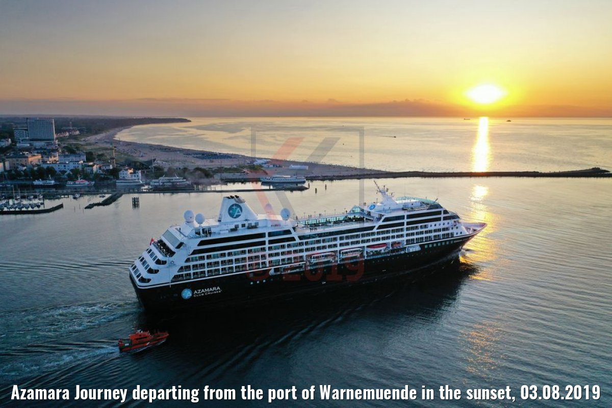 Azamara Journey departing from the port of Warnemuende in the sunset, 03.08.2019