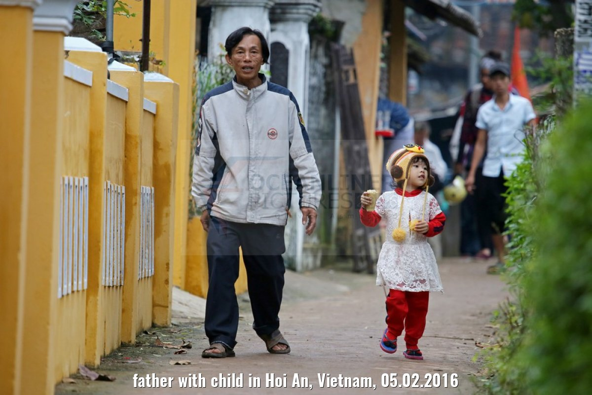 father with child in Hoi An, Vietnam, 05.02.2016