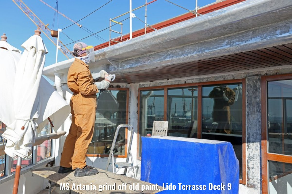 MS Artania grind off old paint, Lido Terrasse Deck 9