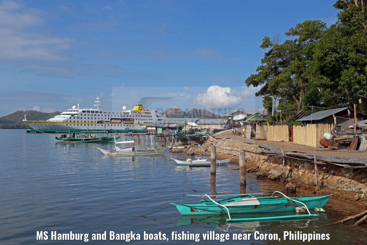 MS Hamburg and Bangka boats, fishing village near Coron, Philippines