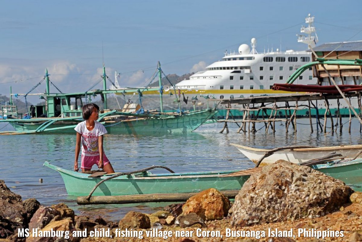 MS Hamburg and child, fishing village near Coron, Busuanga Island, Philippines