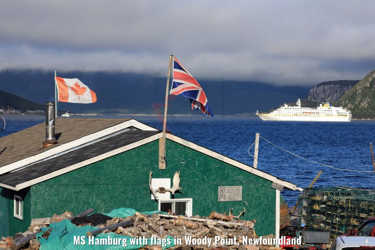 MS Hamburg with flags in Woody Point, Newfoundland