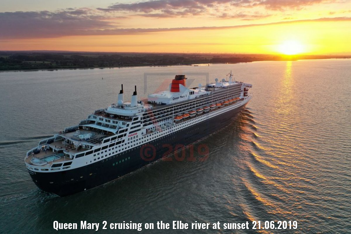 Queen Mary 2 cruising on the Elbe river at sunset 21.06.2019