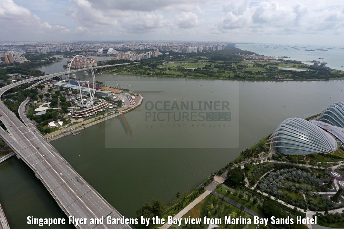 Singapore Flyer and Gardens by the Bay view from Marina Bay Sands Hotel