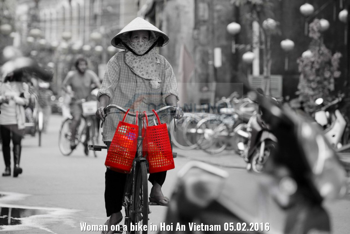 Woman on a bike in Hoi An Vietnam 05.02.2016